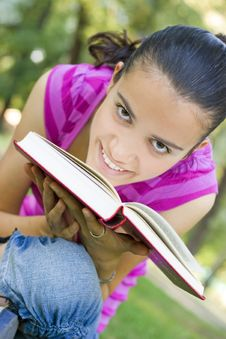 Free Young Woman Reading Outdoor Stock Photo - 5960870