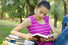 Free Young Woman Reading Outdoor Stock Photo - 5960900