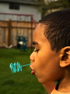 5 Year Old African Amerian Boy Blowing Bubbles Royalty Free Stock Photography