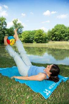 Free Girl Exercising Outdoors With Ball Near Lake Stock Photos - 5961713