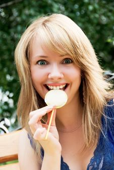 Free Pretty Playful Girl Eating A Candy Royalty Free Stock Photos - 5963248