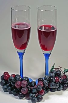 Glasses Of Red Wine & Red Grapes Stock Image
