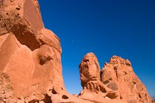 Free Red Rock With Moon Under Blue Sky Stock Photography - 5965462