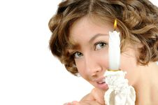 Pretty Curly Girl With Candle Royalty Free Stock Image