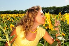 Free Girl Smells A Sunflower Royalty Free Stock Photo - 5967325
