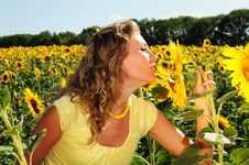 Free Girl Smells A Sunflower Stock Photos - 5967523
