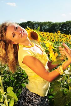 Free Girl With Sunflowers Royalty Free Stock Photo - 5967915