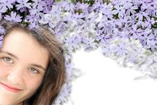 Young Brunette Girl With Purple Flowers Royalty Free Stock Photos