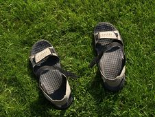 Free Sandals On The Grass Stock Photography - 5968442