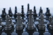 Free Metal Chess Pieces Facing Off Stock Photography - 5969792
