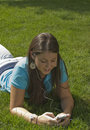 Free Girl In Grass Listening To Music Stock Photo - 5971840