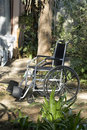 Free Empty Wheelchair In Garden - Vertical Royalty Free Stock Photography - 5975127