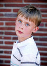 Free Boy Standing Against Brick Wall - Vertical Royalty Free Stock Image - 5975356