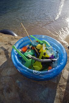 Plastic Paddling Pool Full Of Beach Toys Stock Image