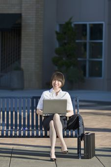 Free Woman Sits On A Bench With Her Laptop - Horizontal Stock Photography - 5975072