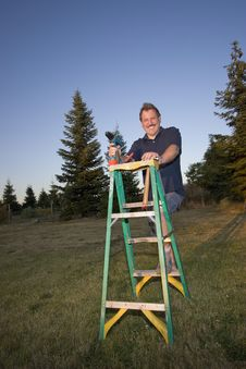Free Man On Ladder - Vertical Royalty Free Stock Photography - 5975427