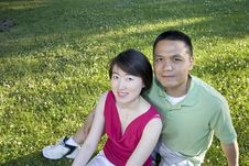 Free Smiling Couple Sitting On Grass - Horizontal Stock Images - 5975444