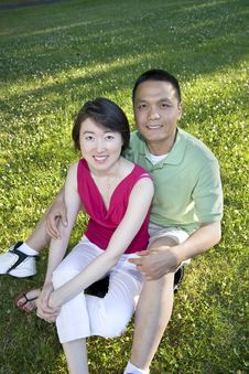 Free Smiling Couple Sitting On Grass - Vertical Royalty Free Stock Photo - 5975455
