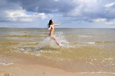 Free Naked Girl Running On The Beach Stock Photography - 5976252