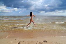 Free Naked Girl Running On The Beach Stock Photos - 5976263