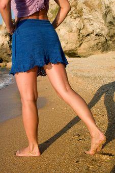 Girl In Blue Skirt On The Sand Beach Royalty Free Stock Photos