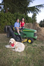 Free Man, Woman, And Dog On A Tractor - Vertical Royalty Free Stock Photos - 5985188
