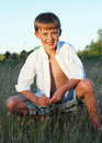 Free Boy Sitting In Field Of Grass - Vertical Royalty Free Stock Images - 5985309