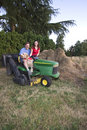 Free Man, Woman, And Dog On A Tractor - Vertical Stock Photography - 5985442