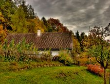 Free Cottage In Autumn With Dark Sky Royalty Free Stock Image - 5982666
