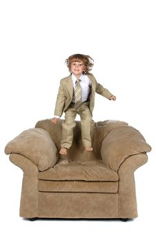 Free Boy In Suit Jumping On Chair Stock Image - 5985031