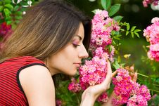 Free Girl Smells Pink Flowers Royalty Free Stock Image - 5985176