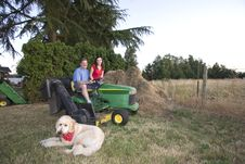 Free Man, Woman, And Dog On A Tractor - Horizontal Royalty Free Stock Image - 5985386
