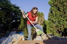 Free Woman Sweeping Through Garbage - Horizontal Stock Image - 5985491
