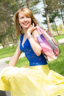 Happy Girl With A Shopping Bag Royalty Free Stock Images