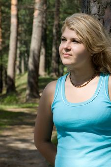 Young Beautiful Woman In A Summer Wood Stock Photo