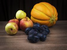 Melon,apples And Plums Stock Photos