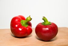 Free Two Ripe Red Peppers On Over White Royalty Free Stock Photography - 59875157