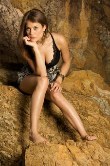 Free Pretty Female Model Sitting On The Rocks Royalty Free Stock Photo - 5992145