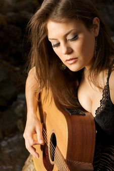 Free Pretty Female Singer Playing Guitar. Royalty Free Stock Image - 5992206