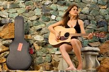 Free Pretty Female Singer Playing Guitar. Royalty Free Stock Photography - 5992227