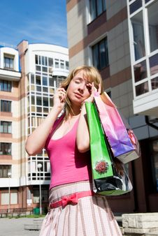 Free Tired Girl With Shopping Bags Royalty Free Stock Photography - 5995917