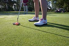 Person Putting On Golf Course - Horizontal Stock Photos