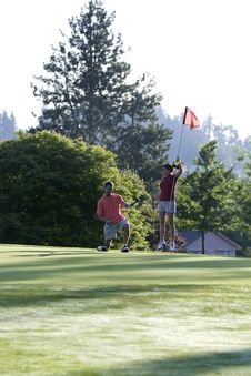 Man And Woman On Golf Course - Vertical Stock Photos