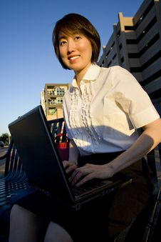 Free Smiling Woman Works On Laptop - Vertical Stock Photography - 5996232