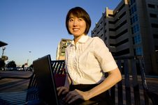 Free Smiling Woman Works On Laptop - Horizontal Royalty Free Stock Photo - 5996235