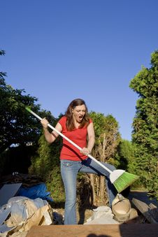 Free Woman Sweeping Through Garbage - Vertical Stock Photography - 5996252