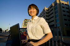 Free Smiling Woman Works On Laptop - Horizontal Royalty Free Stock Photography - 5996307