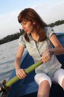 Free Girl Rowing A Boat Stock Photos - 5996863