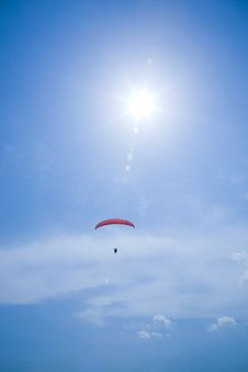 Free Silhouette Of A Parachutist With Red Parachute Stock Photo - 5998950