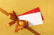 Christmas Or Birthday Card, Gold Gift Ribbon Bow Corner Diagonal, Shiny Gold Background, Copy Space Royalty Free Stock Photo